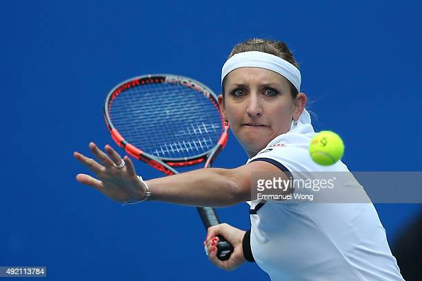 Timea Bacsinszky of Switzerland returns a ball against Ana Ivanovic of Serbia during the Women's single semifinal match on day 8 of the 2015 China...