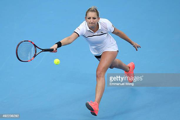 Timea Bacsinszky of Switzerland returns a ball against Garbine Muguruza of Spain during the Women's single final match on day 9 of the 2015 China...