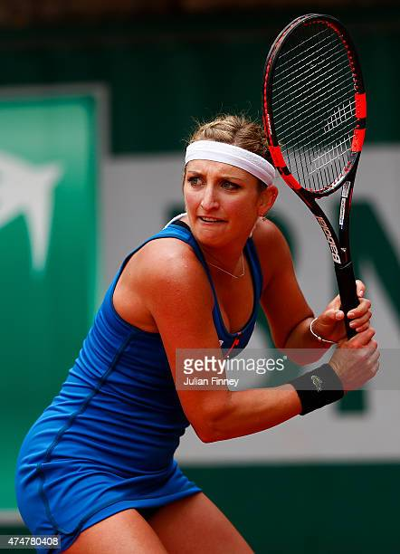 Timea Bacsinszky of Switzerland returns a shot during her women's singles match against Lara Arruabarrena of Spain on day three of the 2015 French...