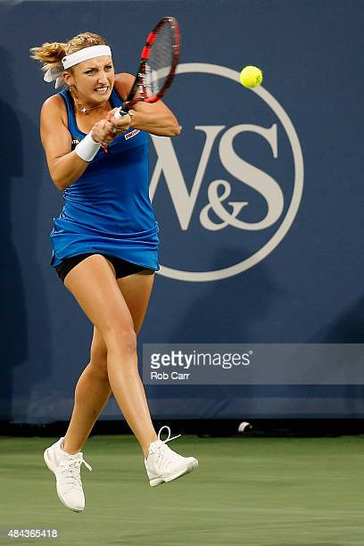 Timea Bacsinszky of Switzerland returns a shot to Madison Keys during Day 3 of the Western Southern Open at the Linder Family Tennis Center on August...