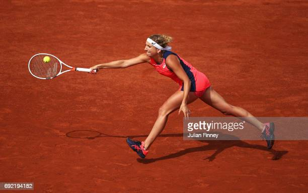 Timea Bacsinszky of Switzerland stretches for a forehand in her women's singles fourth round match against Venus Williams of the United States during...