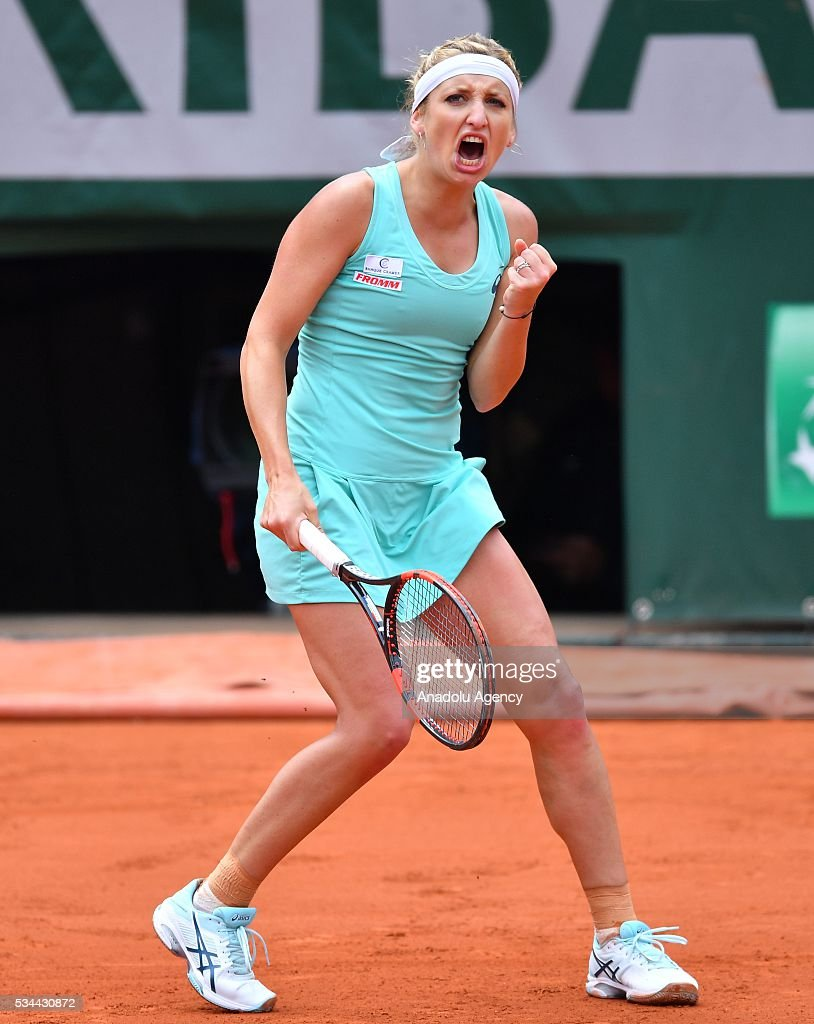 Timea Basinszky of Switzerland reacts during the women's single second round match against Eugenie Bouchard (not seen) of Canada at the French Open tennis tournament at Roland Garros in Paris, France on May 26, 2016.