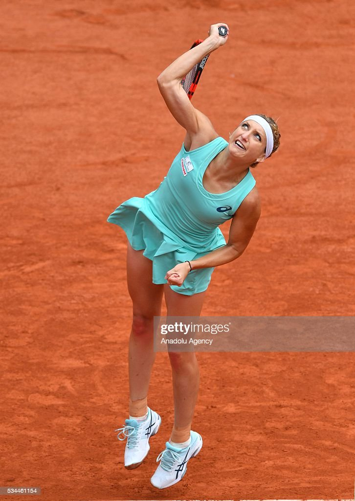 Timea Basinszky of Switzerland serves to Eugenie Bouchard (not seen) of Canada during their women's single second round match at the French Open tennis tournament at Roland Garros in Paris, France on May 26, 2016.