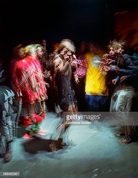 A timeexposure view of dancers under the influence of LSD at an 'Acid Test' Los Angeles California 1966 The 'Acid Tests' were of a series of parties...