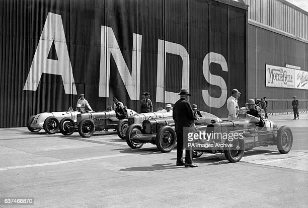 Timekeeper AV Ebblewhite inspects the cars before the race begins
