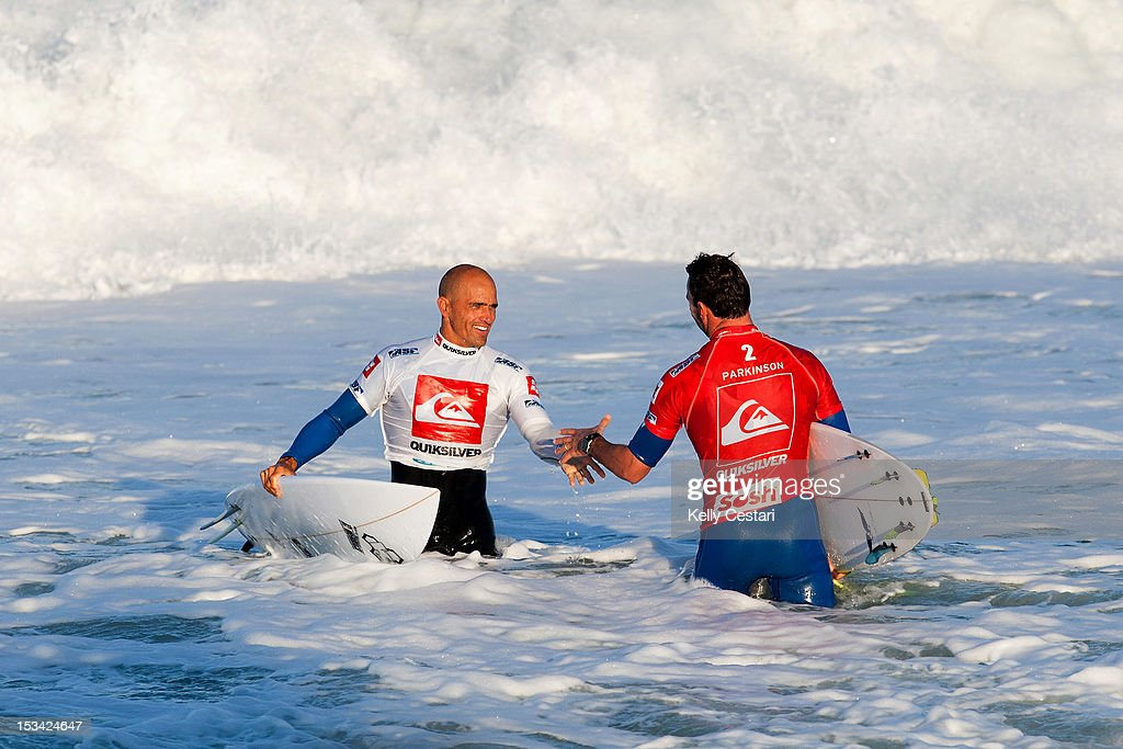 11 times ASP World Champion <a gi-track='captionPersonalityLinkClicked' href=/galleries/search?phrase=Kelly+Slater&family=editorial&specificpeople=207101 ng-click='$event.stopPropagation()'>Kelly Slater</a> of the United States shakes hands with <a gi-track='captionPersonalityLinkClicked' href=/galleries/search?phrase=Joel+Parkinson&family=editorial&specificpeople=234875 ng-click='$event.stopPropagation()'>Joel Parkinson</a> of Australia after defeating him in the Semi Finals of the Quiksilver Pro France on October 5, 2012 in Hossegor, France.