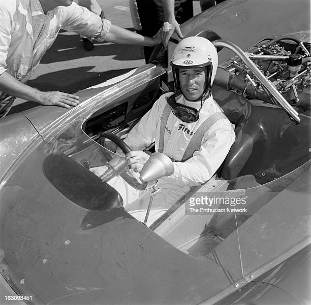 Times Grand Prix Riverside Mario Andretti of the Lola factory team sits in his Chevrolet powered Lola T70 Andretti would suffer an accident in the...