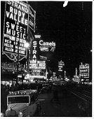 Times Square at night in New York City circa 1940