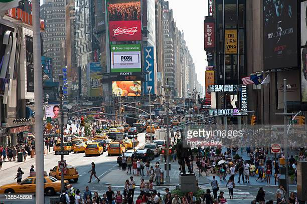 Times Square in New York, crowded with people and traffic