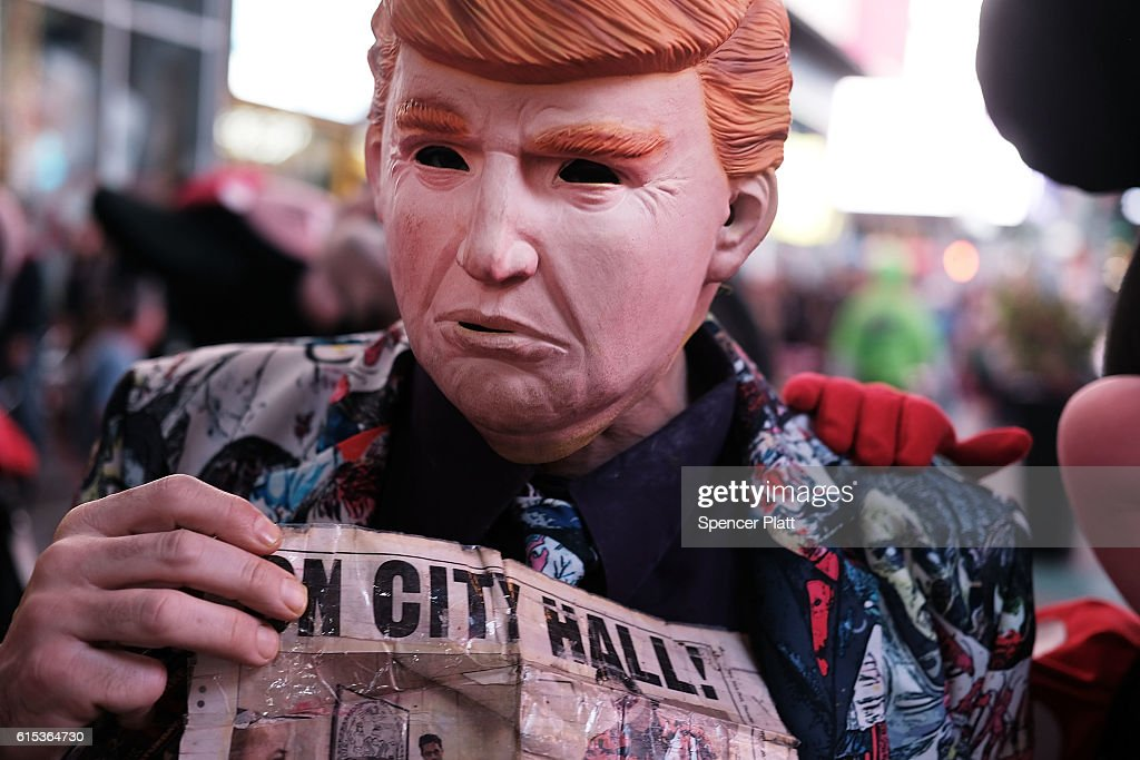 A Times Square performer works in a Donald Trump mask on October 17, 2016 in New York City. As the nation prepares for the final debate between presidential candidates Donald Trump and Hillary Clinton, America has become transfixed on the issues surrounding the two historic candidates. America will go to the poles to pick the next president on November 8.