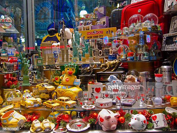 A Times Square store window filled with New York memorabilia and souvenirs for tourists Much of the merchandise mugs ashtrays piggy banks snow globes...