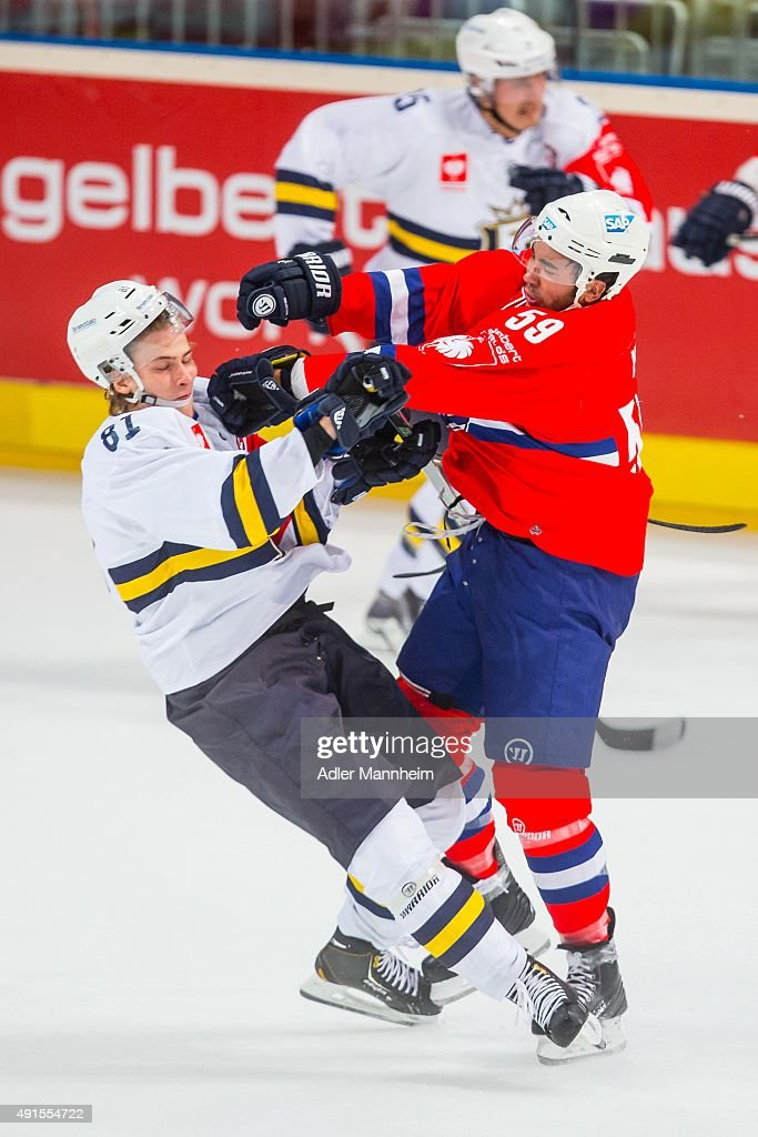 Timi Lahtinen of Espoo Blues clashes with Brandon Yip of Adler Mannheim during the Champions Hockey League round of thirtytwo game between Adler...
