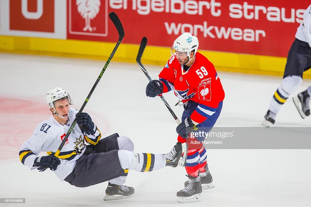 Timi Lahtinen of Espoo Blues in action with Brandon Yip of Adler Mannheim during the Champions Hockey League round of thirtytwo game between Adler...