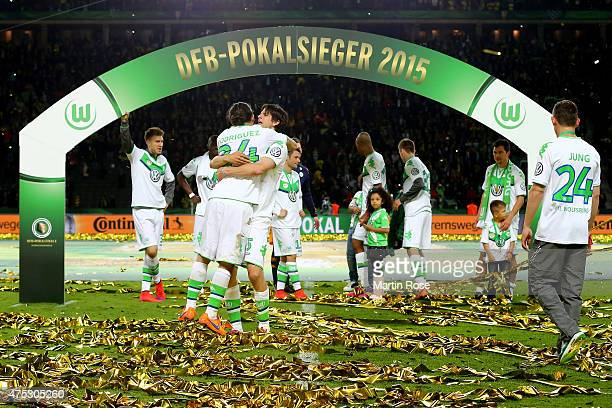 Timm Klose hugs his teammate Ricardo Rodriguez after the DFB Cup Final match between Borussia Dortmund and VfL Wolfsburg at Olympiastadion on May 30...