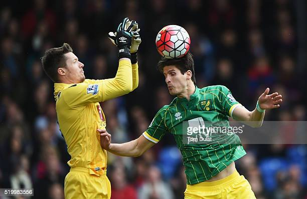 Timm Klose of Norwich City and Wayne Hennessey of Crystal Palace compete for the ball during the Barclays Premier League match between Crystal Palace...