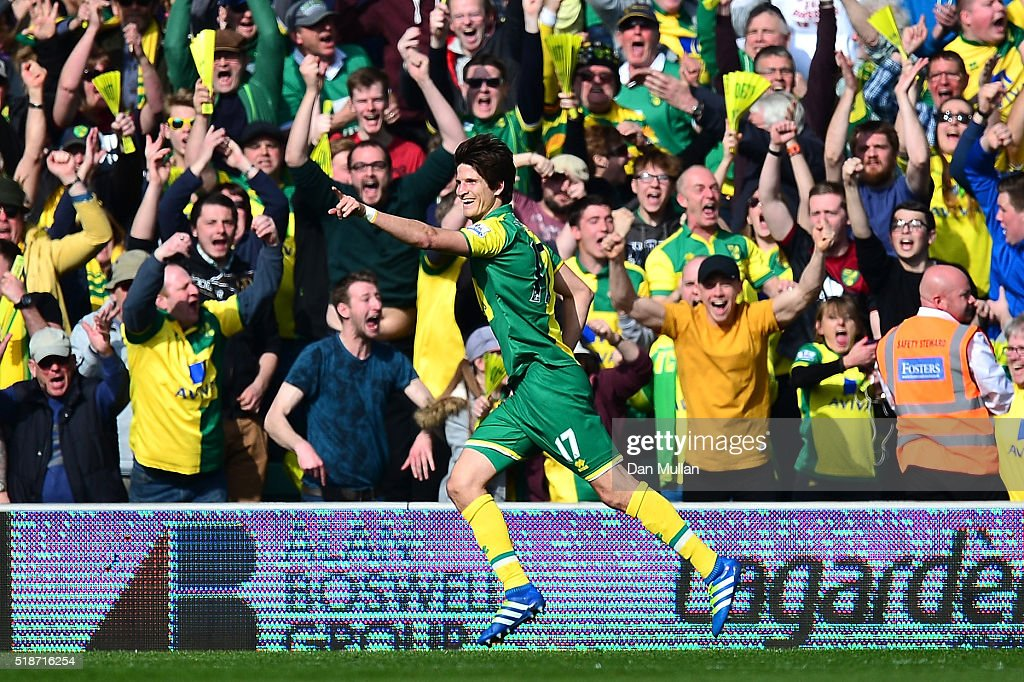 Timm Klose of Norwich City celebrates scoring his team's first goal during the Barclays Premier League match between Norwich City and Newcastle...