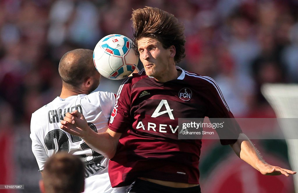 Timm Klose of Nuernberg fights for the ball with Sofian Chahed of Hannover during the Bundesliga match between 1 FC Nuernberg and Hannover 96 at Easy...