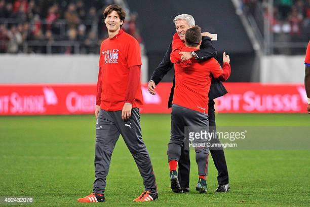 Timm Klose of Switzerland Xherdan Shaqiri of Switzerland and Switzerland's Coach Vladimir Petkovic celebrate as Switzerland qualifies for the UEFA...