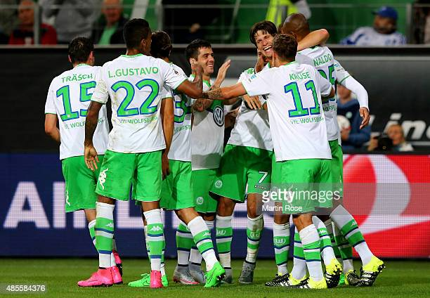 Timm Klose of VfL Wolfsburg celebrates with team mates after scoring his teams third goal during the Bundesliga match between VfL Wolfsburg and FC...