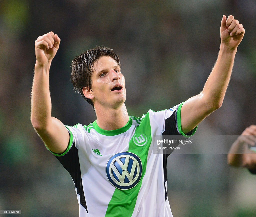 <a gi-track='captionPersonalityLinkClicked' href=/galleries/search?phrase=Timm+Klose&family=editorial&specificpeople=7864194 ng-click='$event.stopPropagation()'>Timm Klose</a> of Wolfsburg celebrates scoring his goal during the second round DFB cup match between VfL Wolfsburg and Vfr Aalen at Volkswagen Arena on September 24, 2013 in Wolfsburg, Germany.