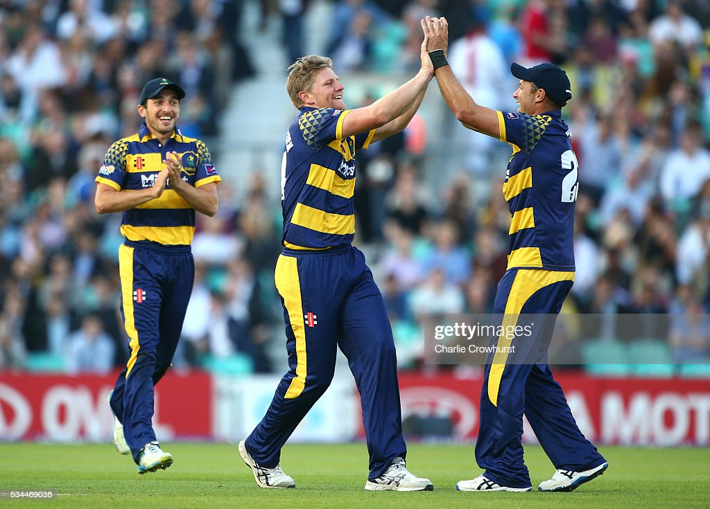 Timm van der Gugten (C) of Glamorgan celebrates taking the wicket of Surrey's James Burke with team mate Dean Cosker (R) during the Natwest T20 Blast match between Surrey and Glamorgan at The Kia Oval on May 26, 2016 in London, England.