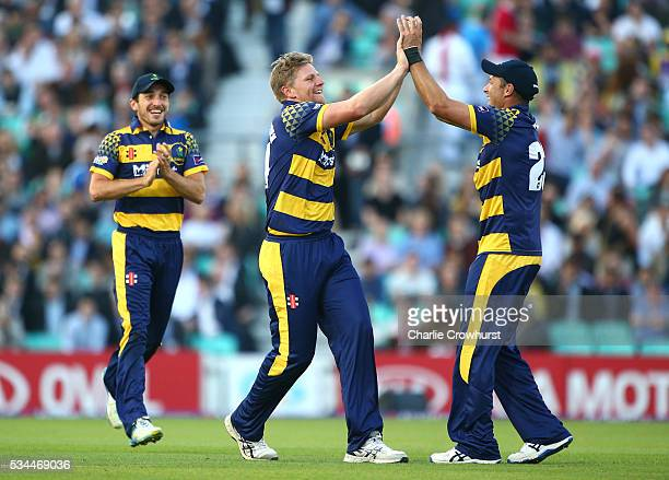 Timm van der Gugten of Glamorgan celebrates taking the wicket of Surrey's James Burke with team mate Dean Cosker during the Natwest T20 Blast match...