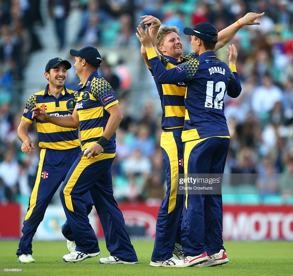 Timm van der Gugten of Glamorgan celebrates with Aneurin Donald after taking the wicket of Surrey's James Burke during the Natwest T20 Blast match between Surrey and Glamorgan at The Kia Oval on May 26, 2016 in London, England.