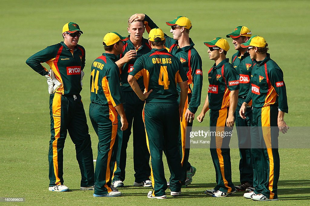 Timm van der Gugten of the Tigers is congratulated by team mates after dismissing John Rogers of the Warriors during the Ryobi One Day Cup match between the Western Australia Warriors and the Tasmanian Tigers at the WACA on February 19, 2013 in Perth, Australia.