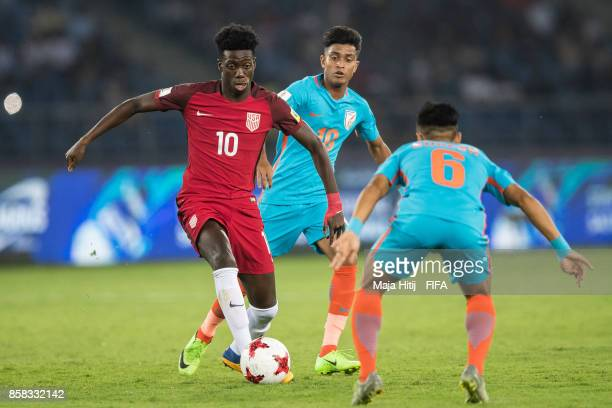 Timm Weah of USA and Abhijit Sarkar of India battle for the ball during the FIFA U17 World Cup India 2017 group A match between India and USA at...