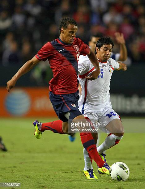 Timmy Chandler of the USA paces the ball on the attack against Alvaro Sanchez of Costa Rica during the International Friendly match at The Home Depot...