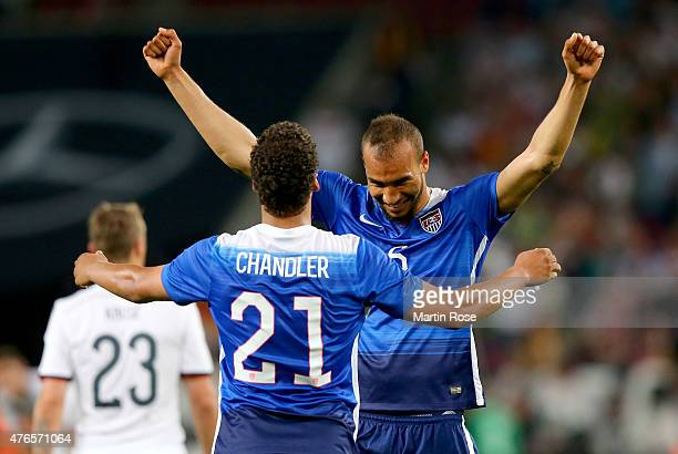 Timmy Chandler of USA celebrate with team mate John Brooks after the International Friendly match between Germany and USA at RheinEnergieStadion on...