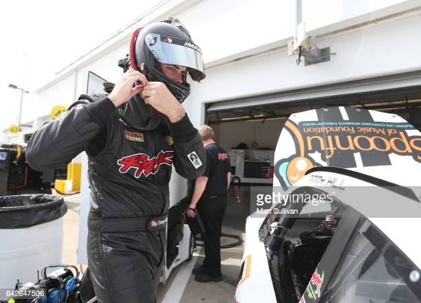 Timmy Hill driver of the Chevrolet gets into his car during practice for the Monster Energy NASCAR Cup Series 59th Annual DAYTONA 500 at Daytona...