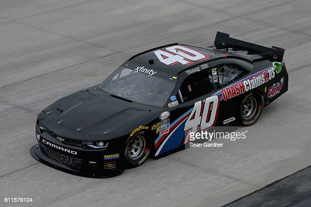 Timmy Hill driver of the CrashClaimsRus Chevrolet drives during practice for the NASCAR XFINITY Series Drive Sober 200 at Dover International...