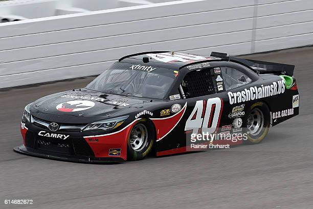 Timmy Hill driver of the CrashClaimsRus Toyota practices for the NASCAR XFINITY Series Kansas Lottery 300 at Kansas Speedway on October 14 2016 in...