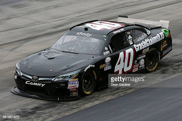 Timmy Hill driver of the CrashClaimsRus/OCR Gaz Bar Toyota practices for the NASCAR XFINITY Series Food City 300 at Bristol Motor Speedway on August...
