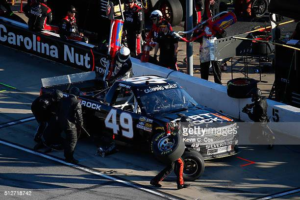 Timmy Hill driver of the Dirt And Rock Chevrolet pits during the NASCAR Camping World Truck Series Great Clips 200 at Atlanta Motor Speedway on...