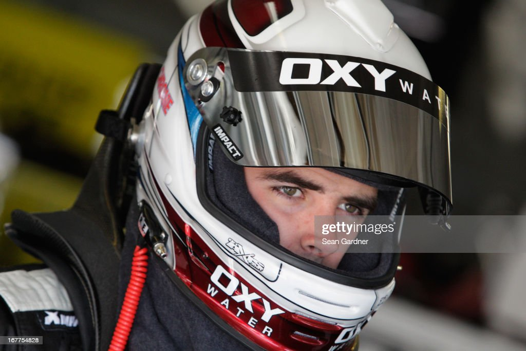 Timmy Hill, driver of the #32 Federated Auto Parts Ford, waits in the garage during NASCAR Sprint Cup Series Gen-6 Testing at Texas Motor Speedway on April 11, 2013 in Fort Worth, Texas.