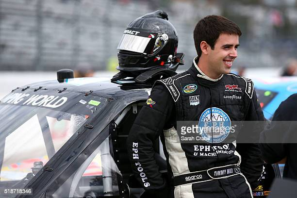 Timmy Hill driver of the JEFA Tech Chevrolet stands on the grid during qualifying for the NASCAR Camping World Truck Series Alpha Energy Solutions...