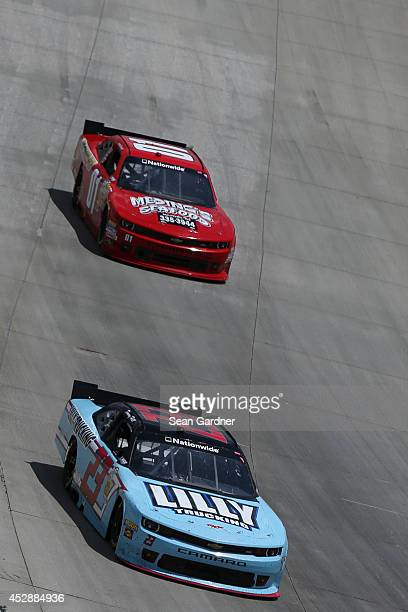 Timmy Hill driver of the Lilly Trucking Chevrolet leads Landon Cassill driver of the Meding's Seafood Chevrolet during the NASCAR Nationwide Series...