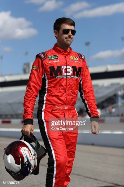 Timmy Hill driver of the OCR Gaz Bar Dodge walks on the grid during qualifying for the NASCAR XFINITY Series Virginia529 College Savings 250 at...