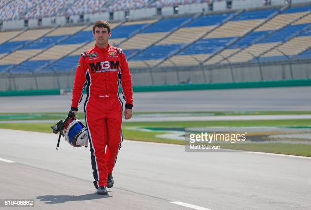 Timmy Hill driver of the OCR Gaz Bar Toyota walks to his car during qualifying for the NASCAR XFINITY Series Alsco 300 at Kentucky Speedway on July 7...