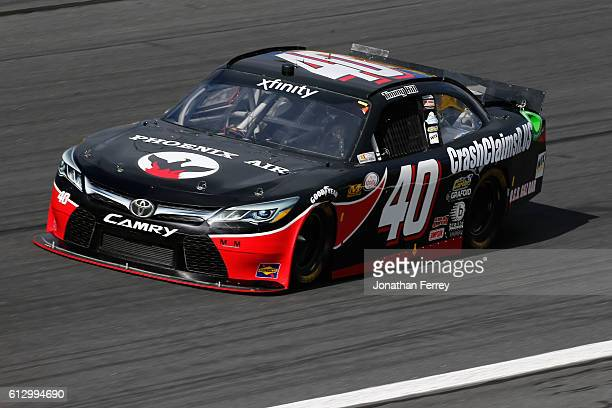 Timmy Hill driver of the OCR Gaz Bar/TLC Vacations Toyota during practice for the NASCAR XFINITY Series Drive for the Cure 300 at Charlotte Motor...