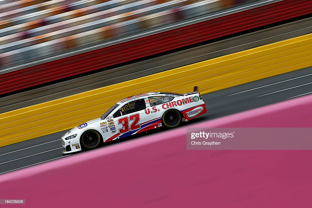Timmy Hill, driver of the #32 U.S. Chrome Ford, during practice for the NASCAR Sprint Cup Series Bank of America 500 at Charlotte Motor Speedway on October 11, 2013 in Concord, North Carolina.