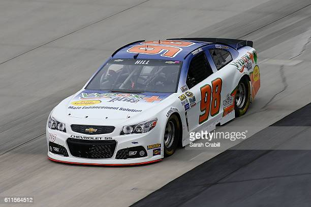 Timmy Hill driver of the Vydox Plus Chevrolet practices for the NASCAR Sprint Cup Series Citizen Solider 400 at Dover International Speedway on...
