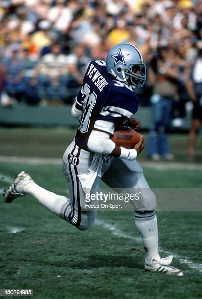 Timmy Newsome of the Dallas Cowboys carries the ball against the Washington Redskins during an NFL football game September 5 1983 at RFK Stadium in...