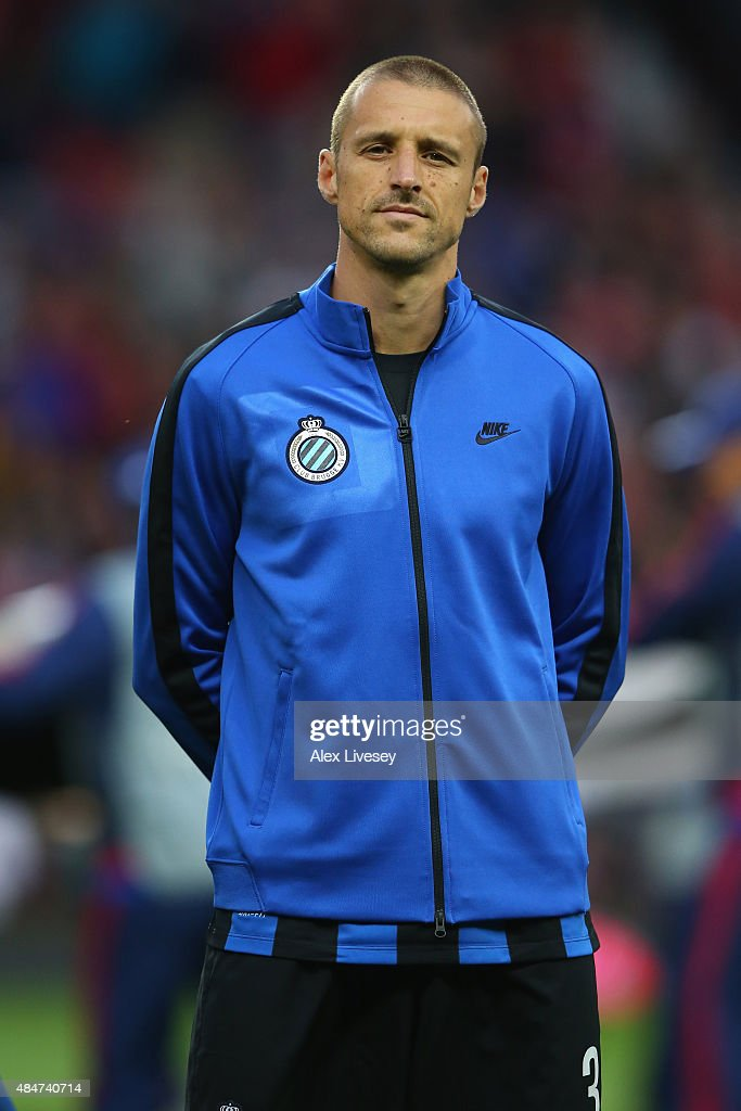 <a gi-track='captionPersonalityLinkClicked' href=/galleries/search?phrase=Timmy+Simons&family=editorial&specificpeople=794114 ng-click='$event.stopPropagation()'>Timmy Simons</a> of Brugge lines up prior to the UEFA Champions League Qualifying Round Play Off First Leg match between Manchester United and Club Brugge at Old Trafford on August 18, 2015 in Manchester, England.