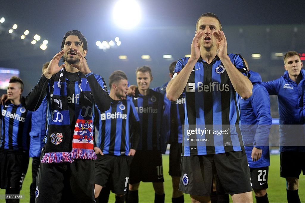Timmy Simons of Club Brugge and Lior Refaelov of Club Brugge celebrating the victory after the Jupiler Pro League Play-Off 1 match between Club Brugge and Sporting Lokeren on March 28, 2014 in the Jan Breydel Stadium in Brugge, Belgium.