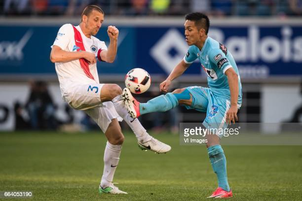 Timmy Simons of Club Brugge Yuya Kubo of KAA Gentduring the Jupiler Pro League Play Off I match between KAA Gent and Club Brugge on April 02 2017 at...
