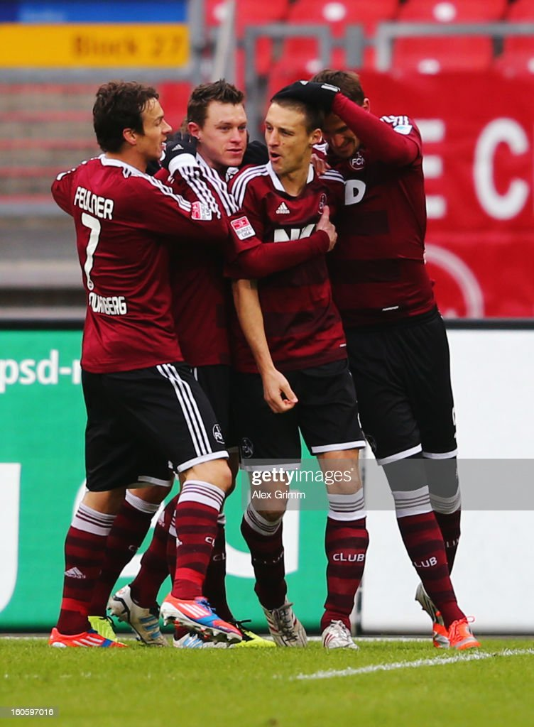 Timmy Simons (2R) of Nuernberg celebrates his team's first goal with team mates Markus Feulner, Hanno Balitsch and Tomas Pekhart (L-R) during the Bundesliga match between 1. FC Nuernberg and VfL Borussia Moenchengladbach at Easy Credit Stadium on February 3, 2013 in Nuremberg, Germany.