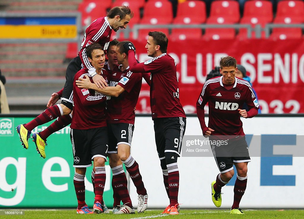 Timmy Simons (C) of Nuernberg celebrates his team's first goal with team mates during the Bundesliga match between 1. FC Nuernberg and VfL Borussia Moenchengladbach at Easy Credit Stadium on February 3, 2013 in Nuremberg, Germany.